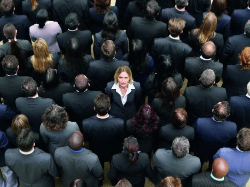 Back view of large group of business people, woman facing opposite direction, elevated view. Image shot 2007. Exact date unknown.