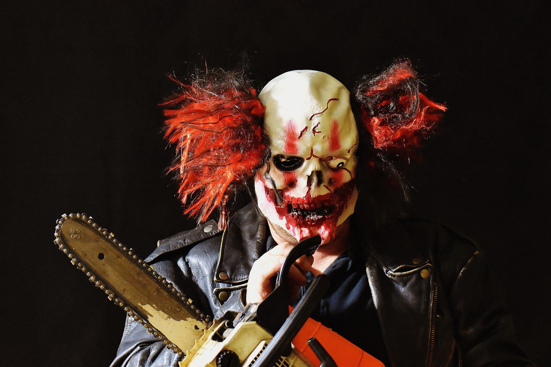 Clown with chainsaw
